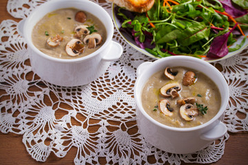 Creamy mushroom soup. Mushroom vegetable soup with thyme and parmesan cheese