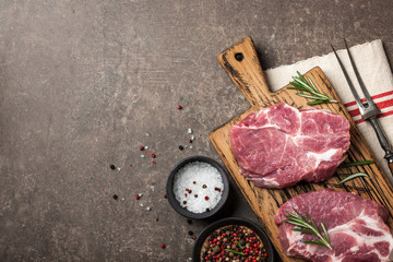 Raw pork steaks with rosemary and spices