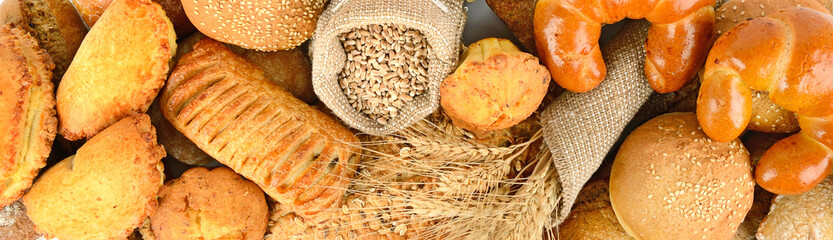 Panoramic background of bread made from wheat and rye flour.