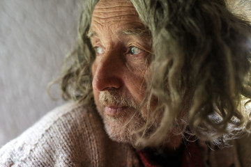 Portrait of old man wit long gray hair