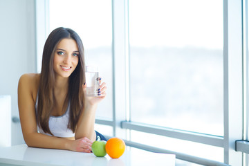 Beautiful Smiling Woman Taking Vitamin Pill. Dietary Supplement