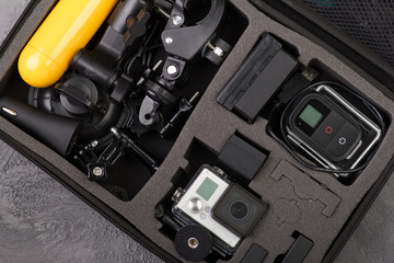 Top view Action camera with accessories in a bag