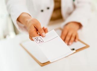 Closeup on medical doctor woman giving prescription