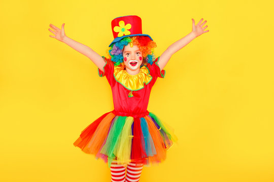 Cheers, victory! Beautiful little girl in carnival costume celebration win