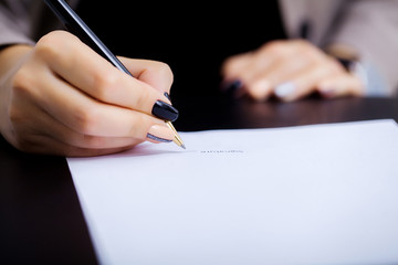 Business woman is signing a contract, business contract details