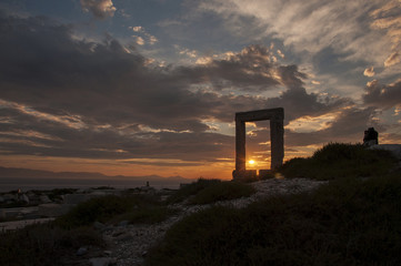 Sunset through Portara monument at Naxos island in Greece