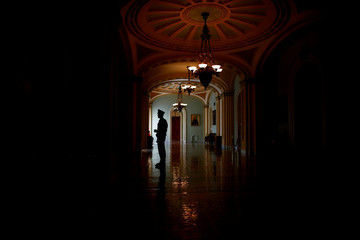 A Capitol police officer is seen in the Ohio Clock corridor on Capitol Hill in Washington