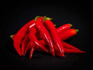 Red Hot Peppers on Black Background