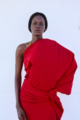 Portrait african dark skin model in red traditional fabric