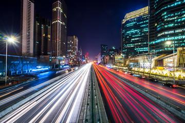 Fotobehang Nacht snelweg busy traffic in urban