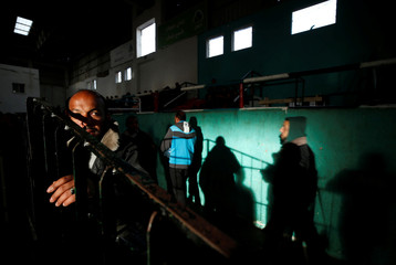 Palestinians wait for travel permits to cross into Egypt through the Rafah border crossing in the southern Gaza Strip
