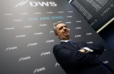 Nicolas Moreau, CEO of Deutsche Bank's asset management unit DWS, poses for pictures at the Frankfurt Stock Exchange