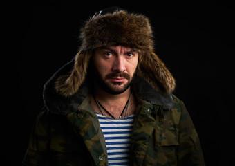 portrait of bearded man is wearing fur hat