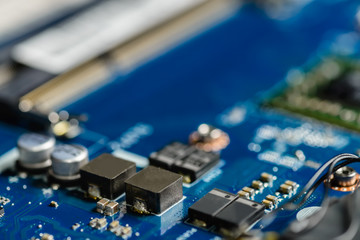 Closeup on electronic board in hardware repair shop. soft focus. Shallow DOF