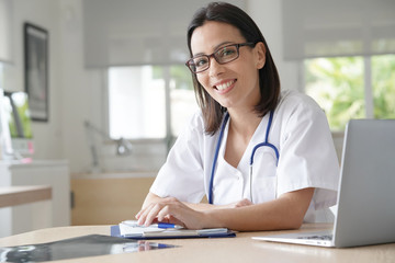 Portrait of woman doctor with eyeglasses in office