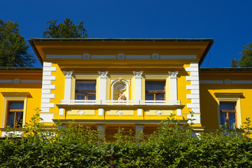 Old house with a yellow facade