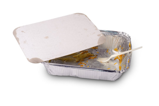 Take away foil plate with leftovers of food and plastic fork