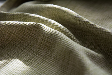 Close-up of a folded green synthetic fabric