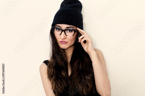 Swag Brunette Girl In Stylish Glasses And Beanie Cap Stock