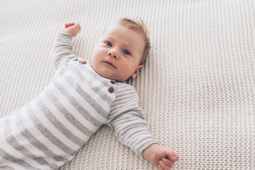 2 month old baby on a blanket