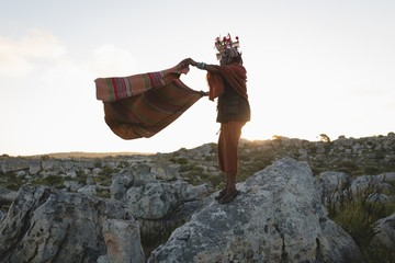 Maasai man in traditional clothing standing with shawl