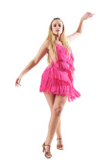 Graceful dance choreography posture of professional female dancer in pink dress. Full body isolated on white background.