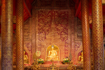 Wall Mural - Buddha image inside the hall in Wat Phra Singh in Chiangmai. Thailand.
