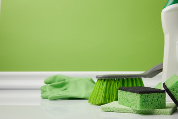 green brush and washing sponges for spring cleaning