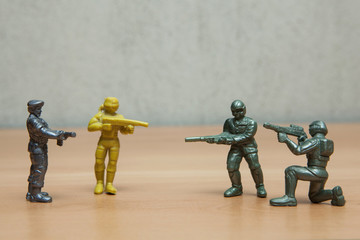 Soldiers games toys on wooden floor.