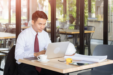 Businessman use laptop in cafe.