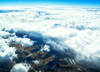 Aerial view of mountains and clouds on top