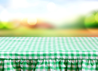 Green white checkered tablecloth with abstract backround summer
