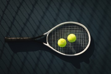 Tennis ball and racket in tennis court