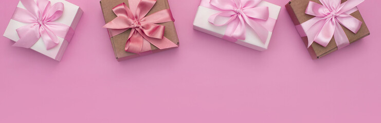 Banner Decorative holiday gift boxes with pink color on pink background.