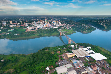 Aerial view of the Paraguayan city of Ciudad del Este and Friendship Bridge, connecting Paraguay and Brazil through the border over the Parana River.