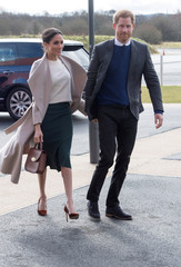 Britain's Prince Harry and his fiancee Meghan Markle arrive for a visit to the Eikon Exhibition Centre in Lisburn
