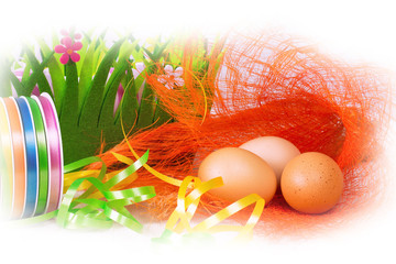 Easter decorations with colorful ribbons, eggs and green grass basket