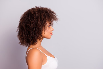 Side view, profile portrait with cope space, empty place of charming, sexy, pretty, attractive, nice girl with modern hairstyle, isolated on grey background, having plump, pout lips