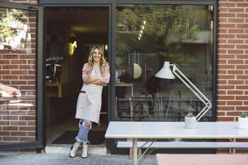 Waitress Standing on Cafe Doors