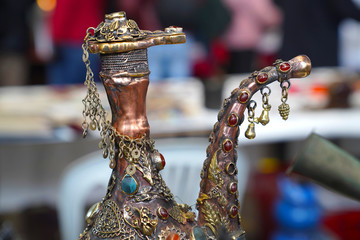 Oriental pitcher decorated with beads and chains