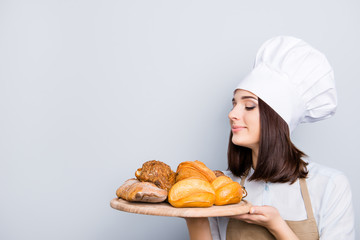 Hungry appetite pleasure eating promo cuisine people manufacture concept. Cropped close up portrait of excited satisfied baker giving round wooden tray full of products isolated on gray background