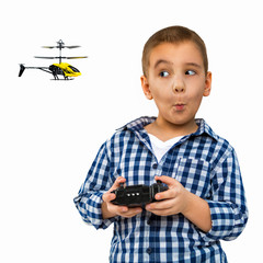 Portrait of a child with a toy. A little boy drives a helicopter. Photo indoors on a white background