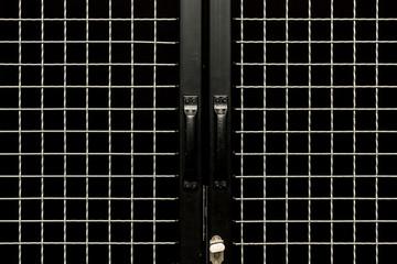 Black doors with handles and metal grit