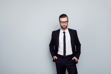 Portrait of virile masculine mature smart expert confident employee keeping hands in pockets wearing white classic shirt black tie blazer classy pants isolated gray background model posing copy-space