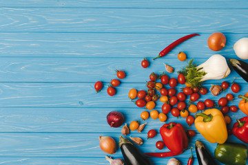 top view of ripe unprocessed vegetables on blue table