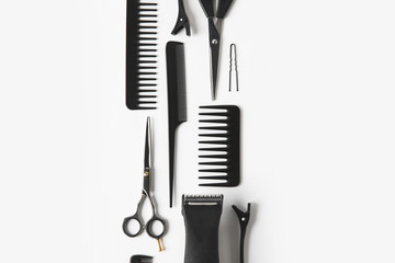 flat lay with hair clipper and hairdressing tools, on white
