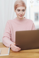 Attractive woman working on a laptop computer
