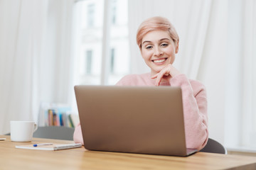 Happy young businesswoman smiling as she reads
