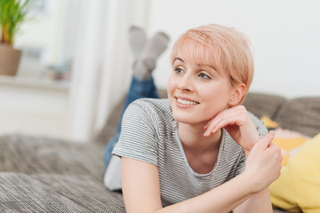 Relaxed smiling woman watching to the left