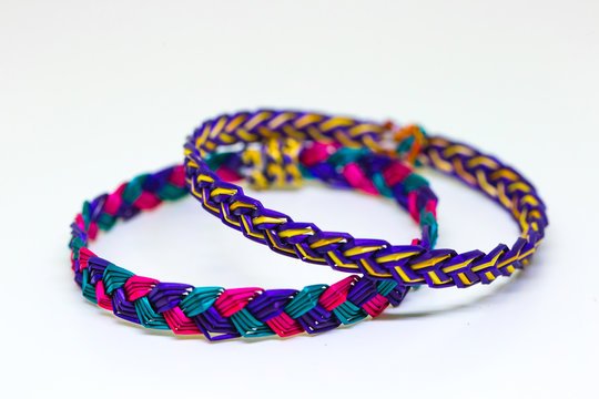 The extreme ordinary colorful bamboo wrist bands in the white background studio which made by hill tribe and can be seen in many places and no people holds the art copyright.